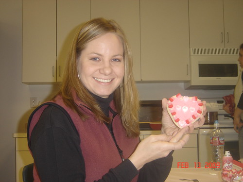 Here I am with my pink cookie. It wasnt until I finished decorating it before I read the label on the frosting container - cream cheese! Since I am so not a fan, I couldnt eat my pretty cookie.