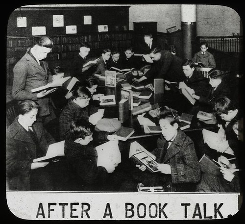 Work with schools : after a book talk, showing boys gathered... by New York Public Library.