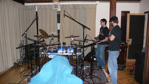 Santoro and Tom wonder where they can attach a tambourine to the drumset