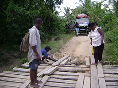 Repairing a bridge before crossing.