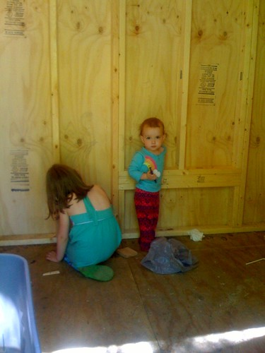 girls drawing in the chicken coop