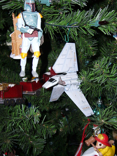 A Star Wars ornament. Im told its called a Lambda. It plays the Star Wars theme song when you push its button. The button was pushed often.
