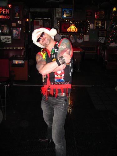 Brian Grosz as Tattooed Santa Pimp. At his Ugly Holiday Sweater Jamboree.