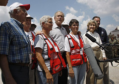 President George W. Bush stands with a group of Red Cross volunteers 09.02.2008