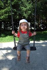 Kind auf einer Schaukel