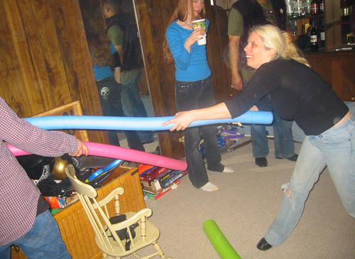 20080112 - Greg & Nicole's party - 149-4969 - Carolyn, Nicole (bg) - Noodle Fight!