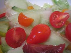 salad of heirloom cherry tomatoes, honeydew, and cucumbers