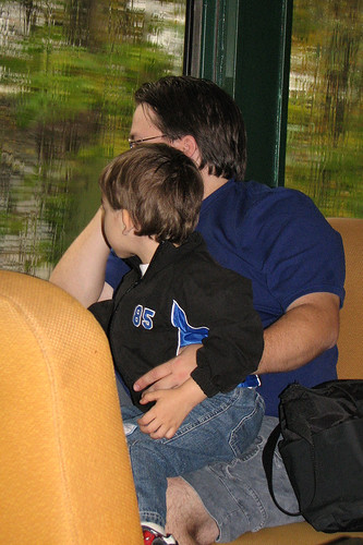 Bug and Daddy looking out the rainy window