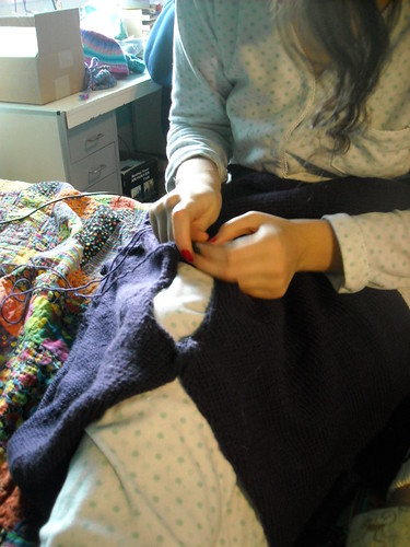 Sewing up the sweater.