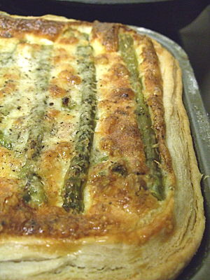 half the asparagus quiche i made - this, cut in half, serves two (with lots of mash and peas).