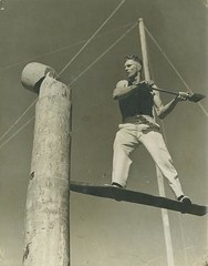 Champion axeman Charlie Winkle competing in a ...