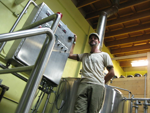 Driftwood brewmaster, Jason Meyer, stands in front of his vented mash tun.