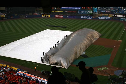 right after we arrived, they took the tarp off the infield...