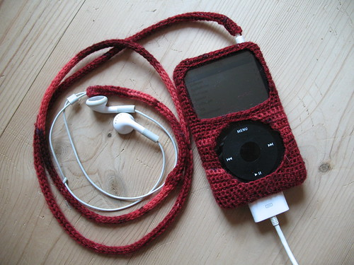 Crafter & photographer: Lisa Risager. The iPod cozy is crocheted, the cord cover is a knitted iCord