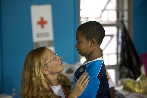 Red Cross volunteer Hope Koestner speaks with Alfred Hyams at a Red Cross shelter in Baton Rouge, Louisiana.
