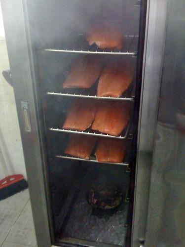 Salmon, smoking away above Ice Cubes to keep cool!