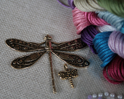 Close up of dragonfly charms