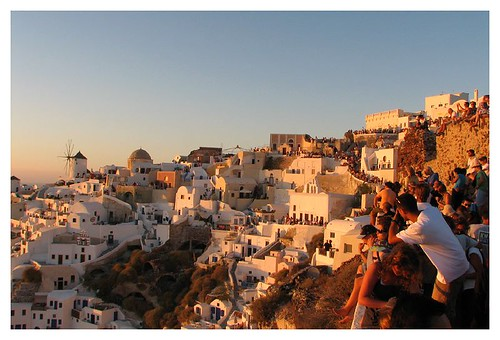 The crowd watching sunset at Oia by you.