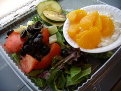 Salad and cottage cheese and oranges