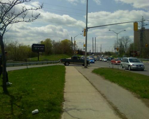 car blocking sidewalk