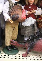 dinosaur eats Mormon dolls