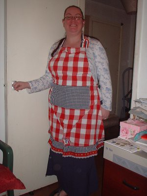 me, proudly wearing my Dutch apron - its the colours of the Dutch flag, of course, and theres a little ceramic clog at the base of the teatowel!
