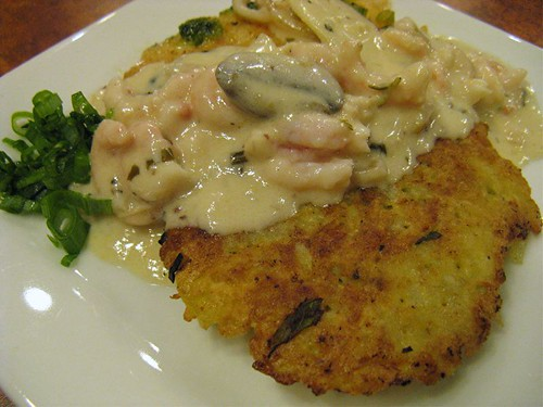 potato pancake with sole and seafood sauce
