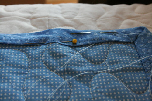 After a zigzag binding failed miserably, I'm hand sewing.