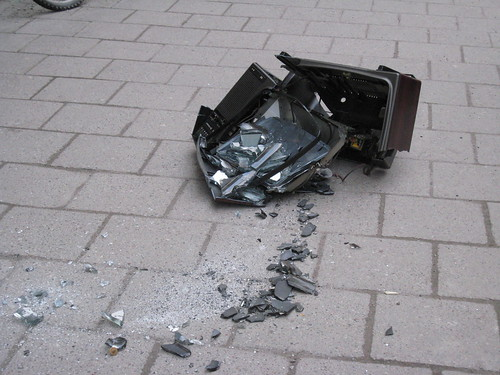 Smashed tv-set on the pavement