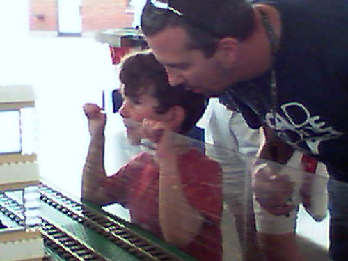 Ethan and Daddy staring at the Lego train