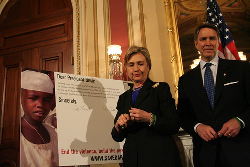 Clinton signing the one millionth Million Voices for Darfur card to Bush