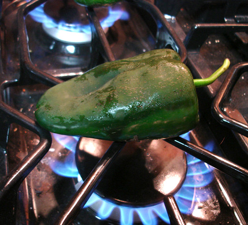 A Poblano pepper vs. the blue flames of hell. Cue metal guitar