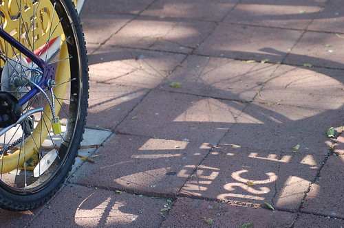 Bicycle shadows by you.