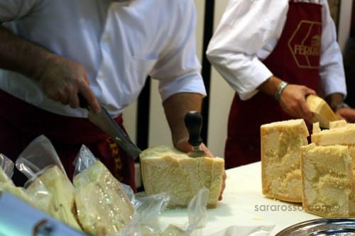 Wedging apart Parmigiano Reggiano at at Salone del Gusto in Turin