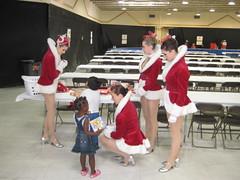Rockettes visit Auchan Shelter in Houston