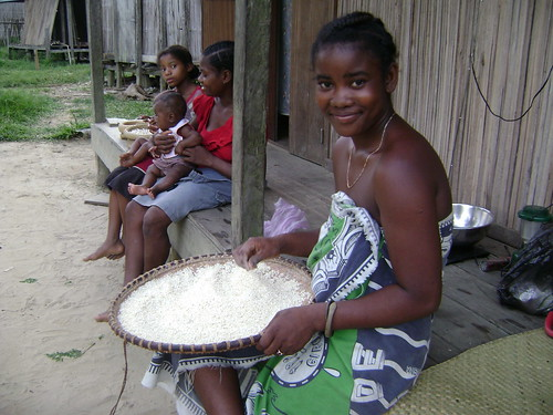 Research teams cook prepares rice for dinner. How beautiful is she?!