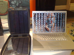 151020081048 solar gorilla laptop charges next to macbook pro for scale