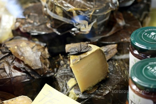 Pecorino cheese wrapped in Walnut Leaves at Salone del Gusto in Turin