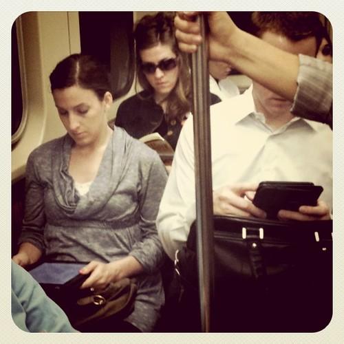 CTA Reads: iPad, Kindle, old school book.