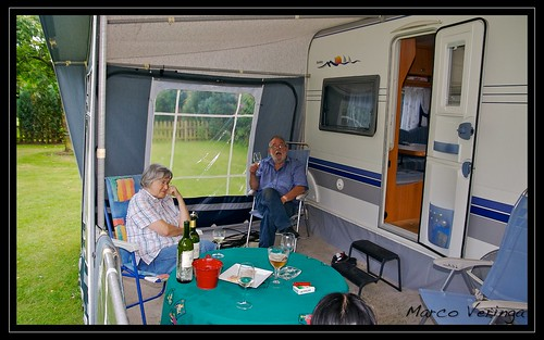 Opa and Oma in the voortent of de Caravan, enjoying a good glass of wine!