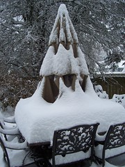 patio table with a few more inches of snow