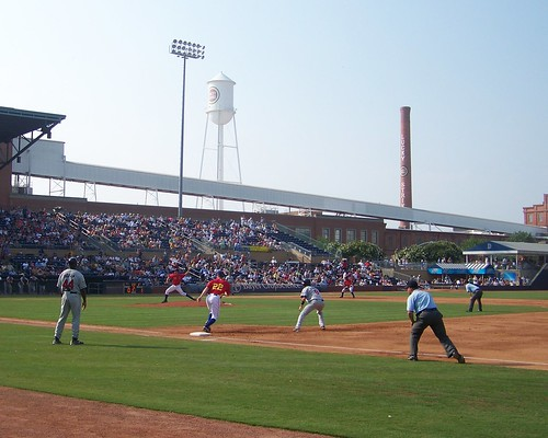 Durham Bulls - Man on first, pitcher delivers