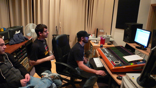 Tom, Santoro and some random dude listen to some drum tracks