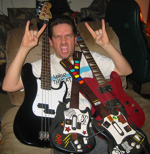 20070323 - Hanging out at Clint & Carolyn's - 115-1584 - Clint covered in guitars