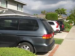 mini-vans and suvs in driveways