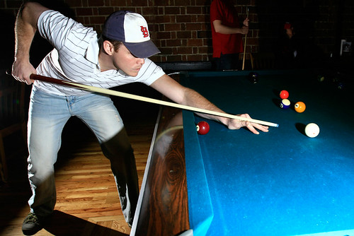 Caption: MU student John Stone gets ready to strike the ball in a game of pool at Billiards on Broadway on April 20. Billiards on Broadway was previously located on Ninth Street. My only criticisms: You cant see Johns eyes, and the highlights in the lower righthand corner are a bit blown.