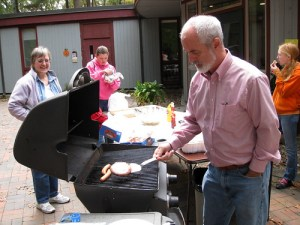 Grilling at our annual Octoberfair fundraiser.