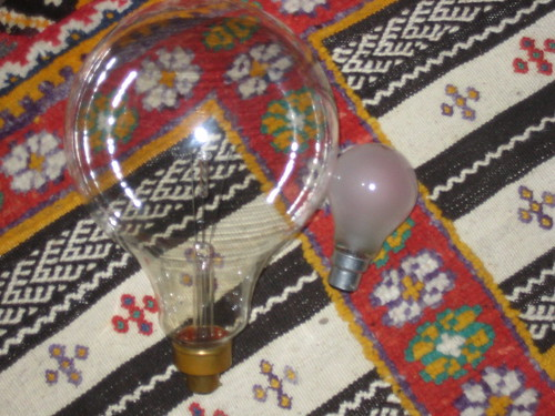 An ENORMOUS novelty lightbulb. Also pictured is a normal lightbulb to give a sense of scale.