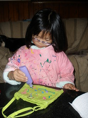Olivia Decorating a Purse with Fabric Paint