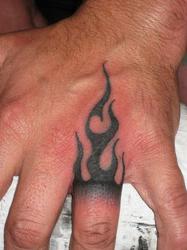 Tribal Flame hand tattoo by Jon Poulson
